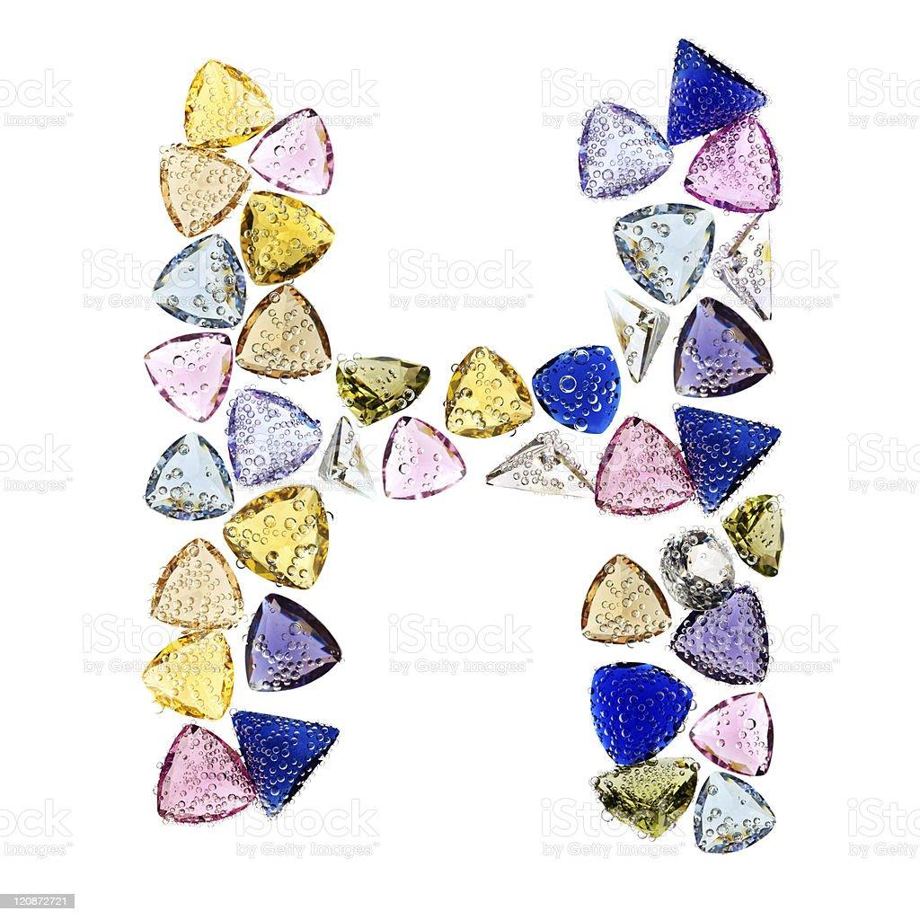 Gemstones alphabet, letter H. Isolated on white background. royalty-free stock photo