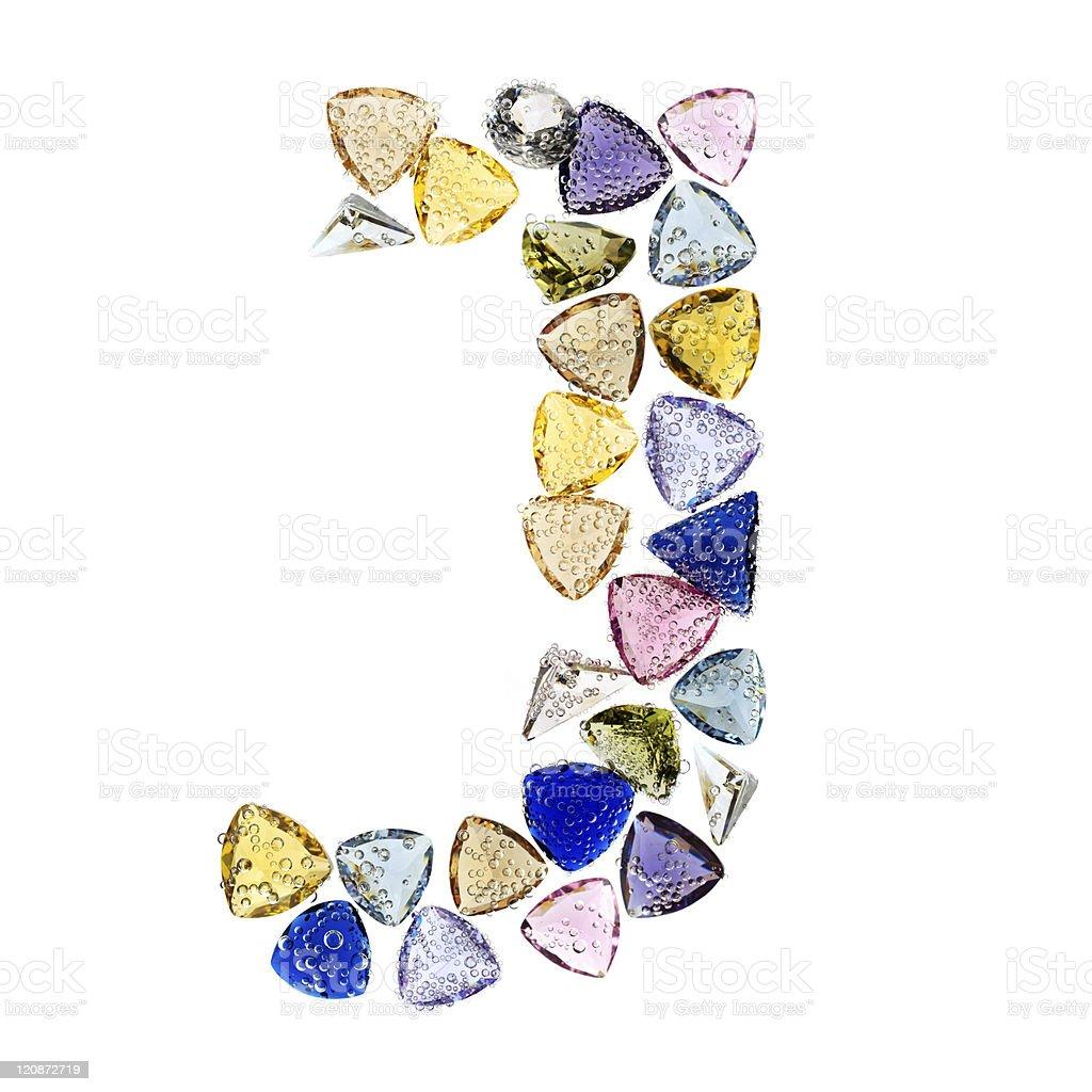Gemstones alphabet, letter J. Isolated on white background. royalty-free stock photo