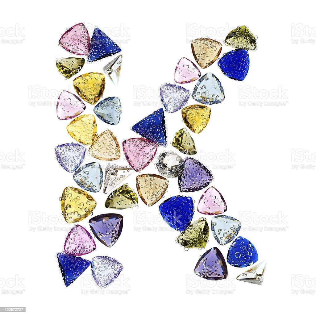 Gemstones alphabet, letter K. Isolated on white background. royalty-free stock photo
