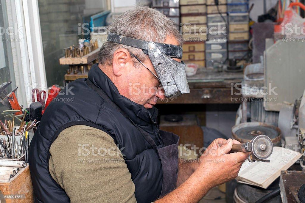 Gemstones grinding workshop stock photo
