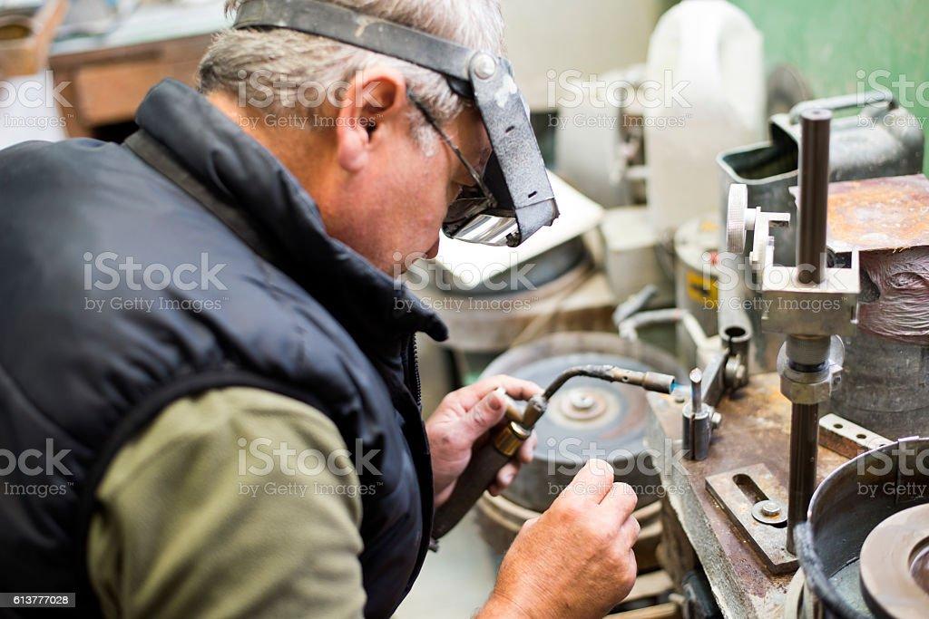 Gemstones grinding,Faceting machine stock photo