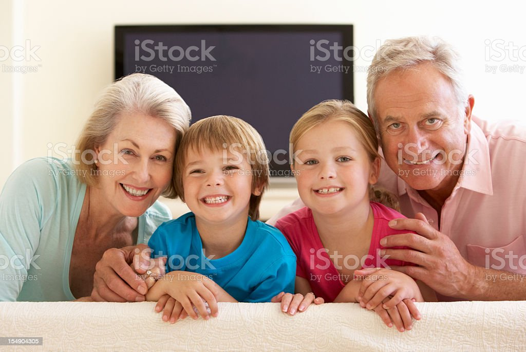 3 Gen Family Watching Widescreen TV At Home royalty-free stock photo