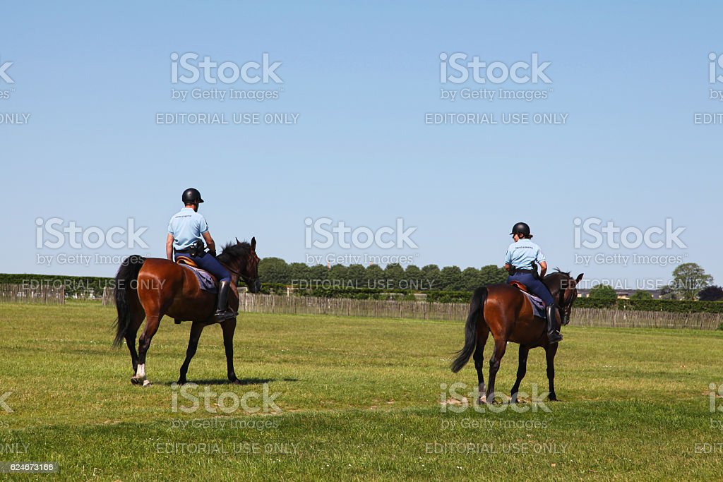 Gendarmes patrolling on horseback stock photo