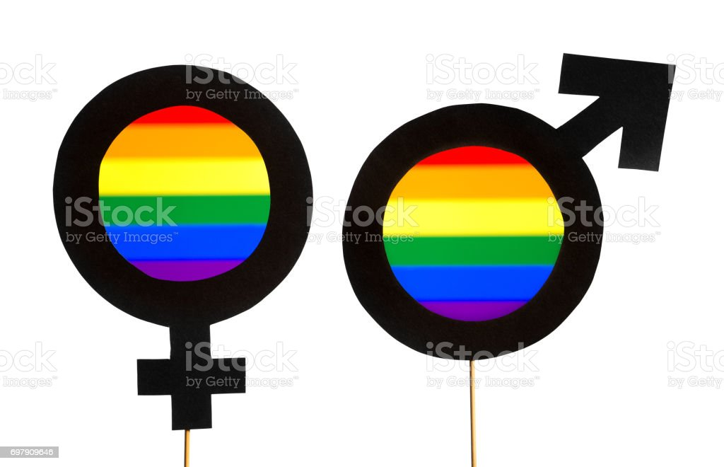 Gender symbols with LGBT and rainbow flag colors. Man and woman support equality. Gay pride, homosexuality, and sexual minority concept. Male and female cardboard signs on wooden sticks on white. stock photo