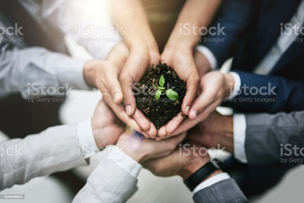 Generating growth by joining forces stock photo