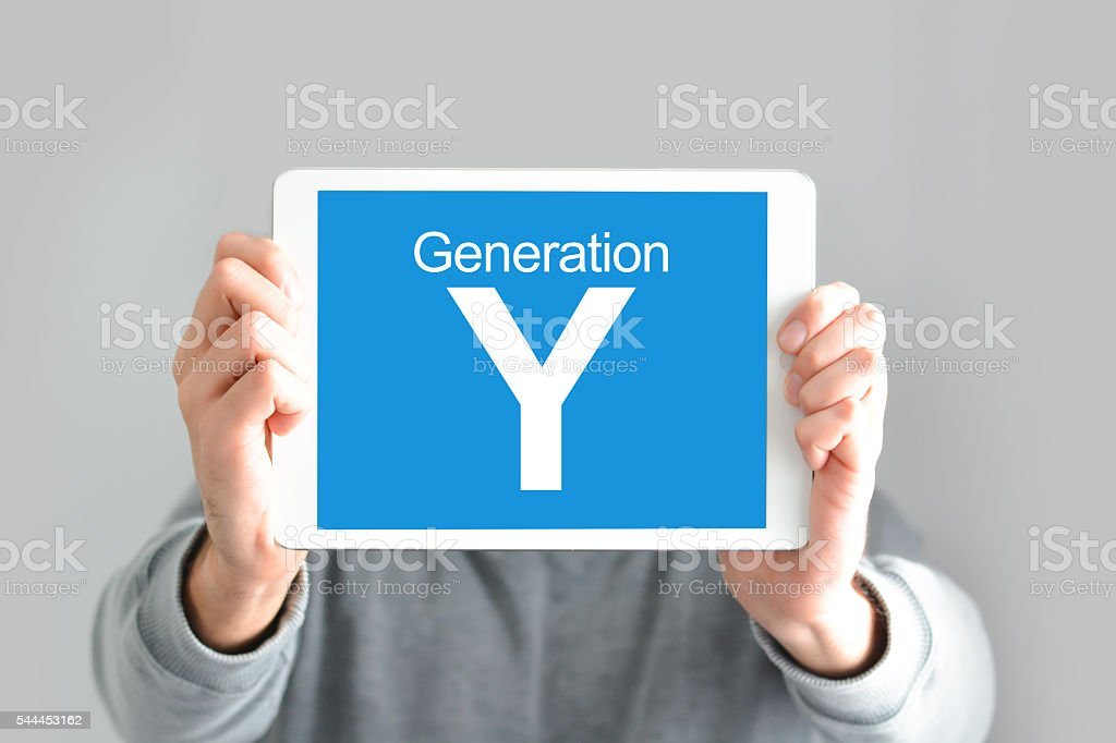 Y generation concept with young man holding a digital tablet stock photo