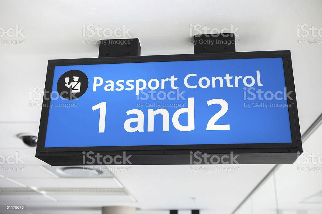 Generic blue passport control sign at airport stock photo