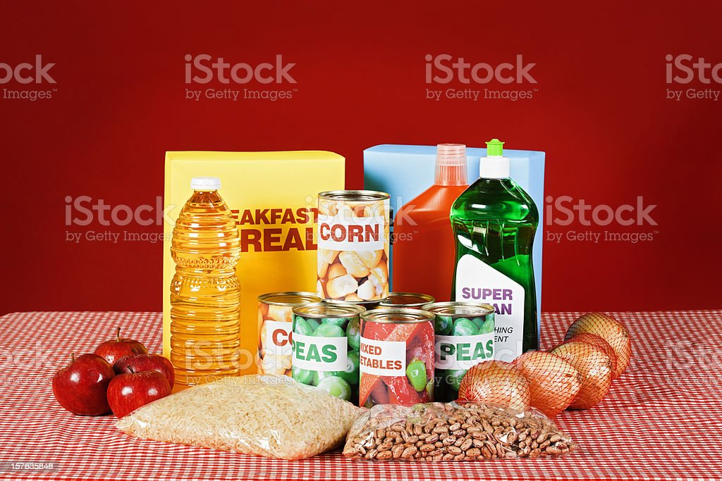 Generic food and cleaning products on gingham against red