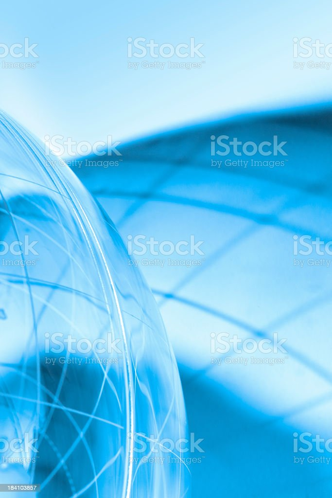 Generic globe with no land features on a blue background royalty-free stock photo