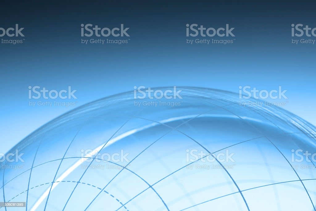 Generic globe with no land features on a blue background stock photo