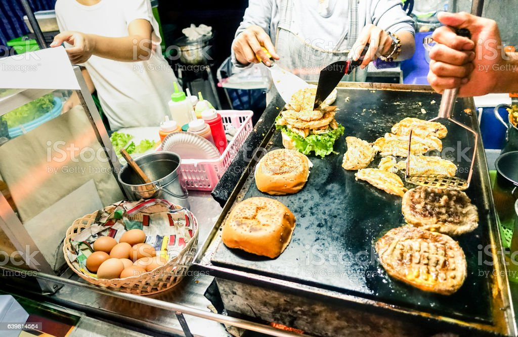 Generic hamburger vendors cooking beef and chicken burgers stock photo