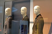 Generic mannequins behind glass