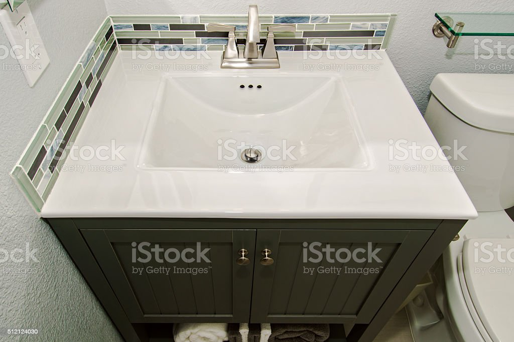 Generic Remodeled Bathroom Cabinet and Sink Detail stock photo