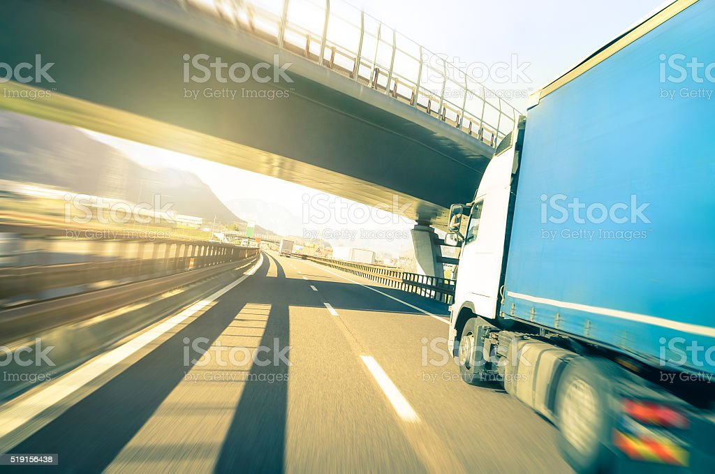 Generic semi truck speeding on highway - Logistic transport concept stock photo
