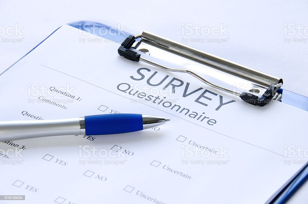 Generic survey questionnaire on clipboard with pen stock photo
