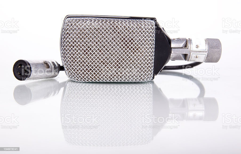 Generic Vintage Microphone on a White Background royalty-free stock photo