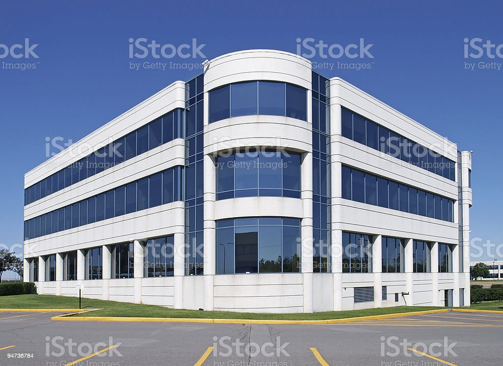 A generic white window building in an empty parking lot stock photo