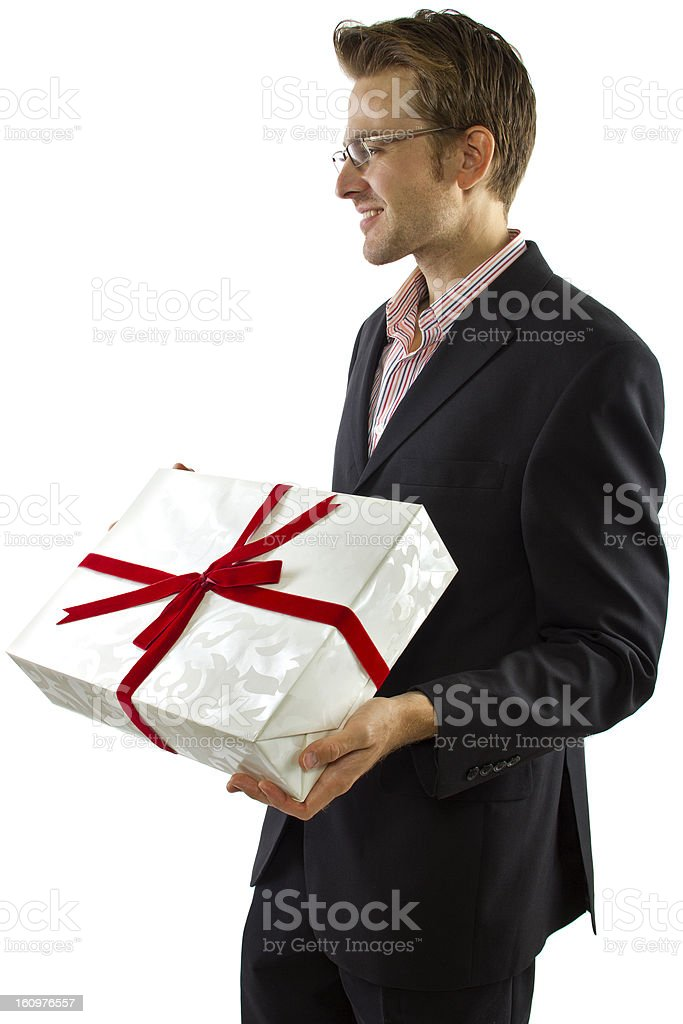 Generous Boyfriend Wearing a Suit Holding a Gift stock photo
