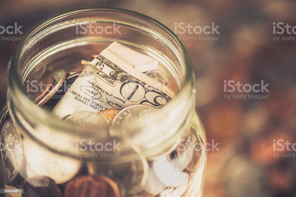 Generous Donation: Fifty Dollar Bill in Donation Jar stock photo