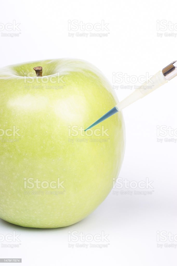 Genetically modifying an apple royalty-free stock photo