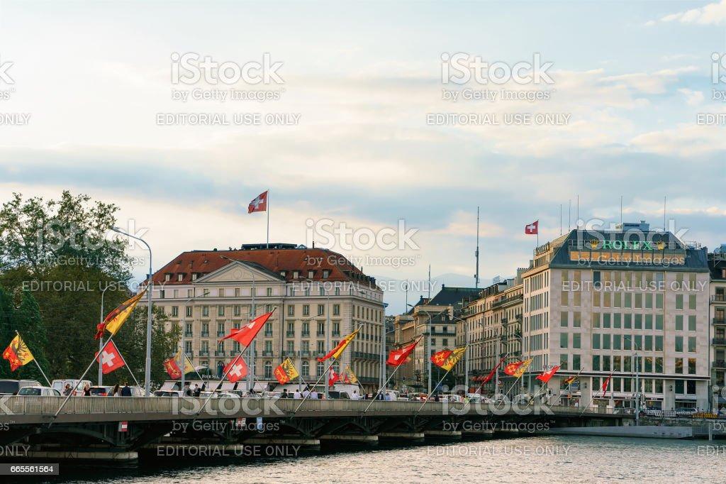 Geneva Lake and Mont Blanc bridge Swiss flags people stock photo