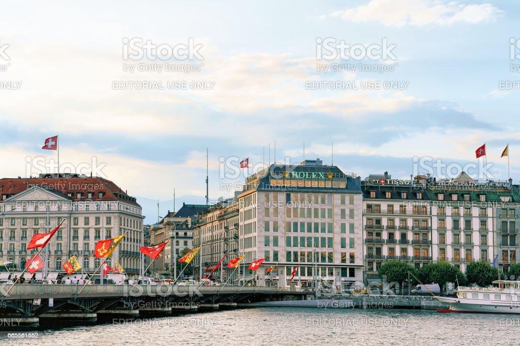 Geneva Lake and Mont Blanc bridge Swiss flags stock photo