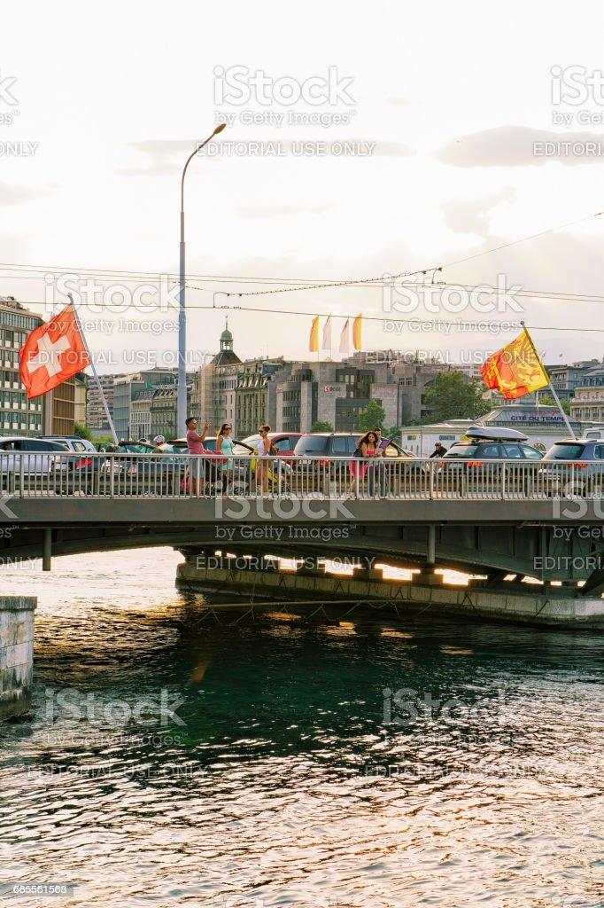 Geneva Lake and Mont Blanc bridge Swiss flags Switzerland stock photo