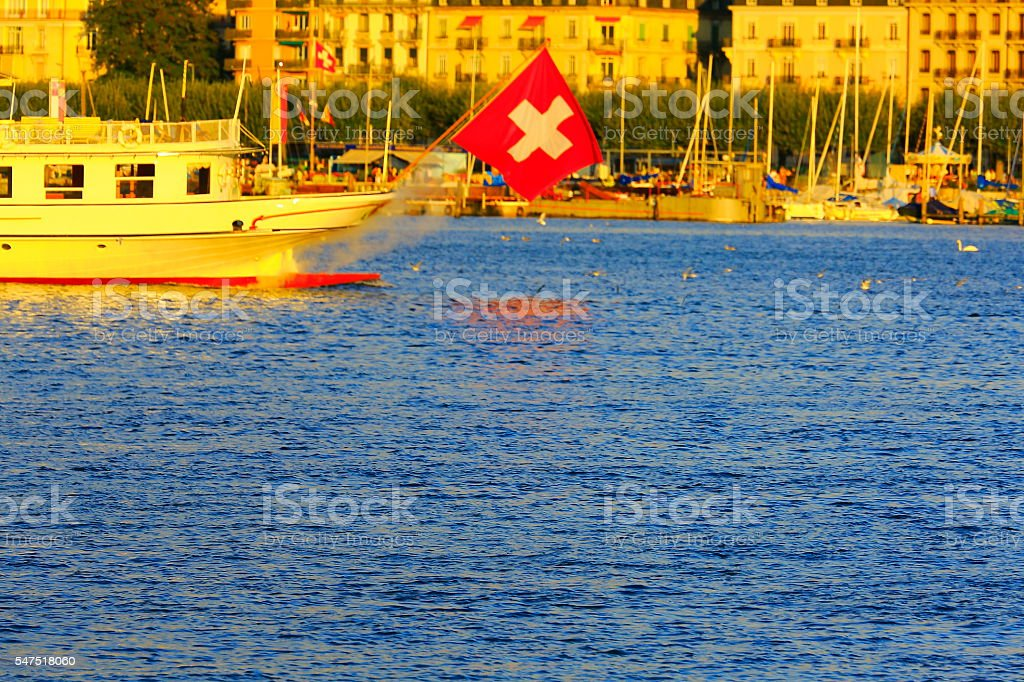 Geneva lake cruise, Swiss Flag - Marina Pier yachts sunset stock photo