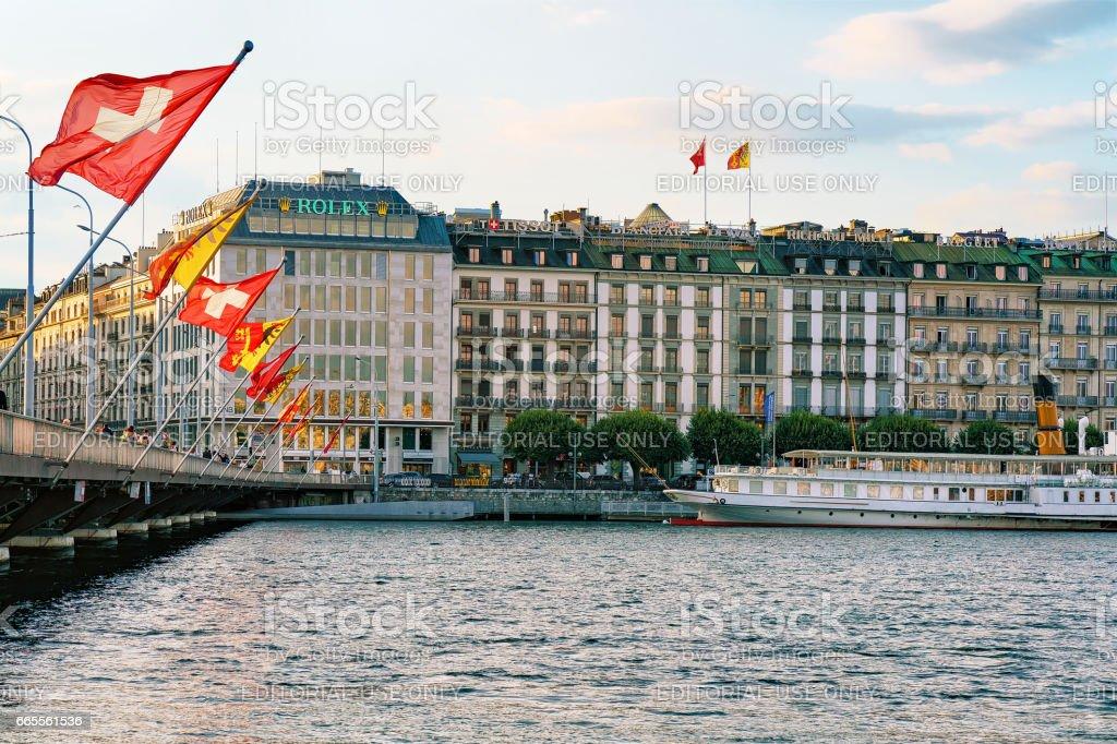 Geneva Lake Mont Blanc bridge with flags Geneva city stock photo