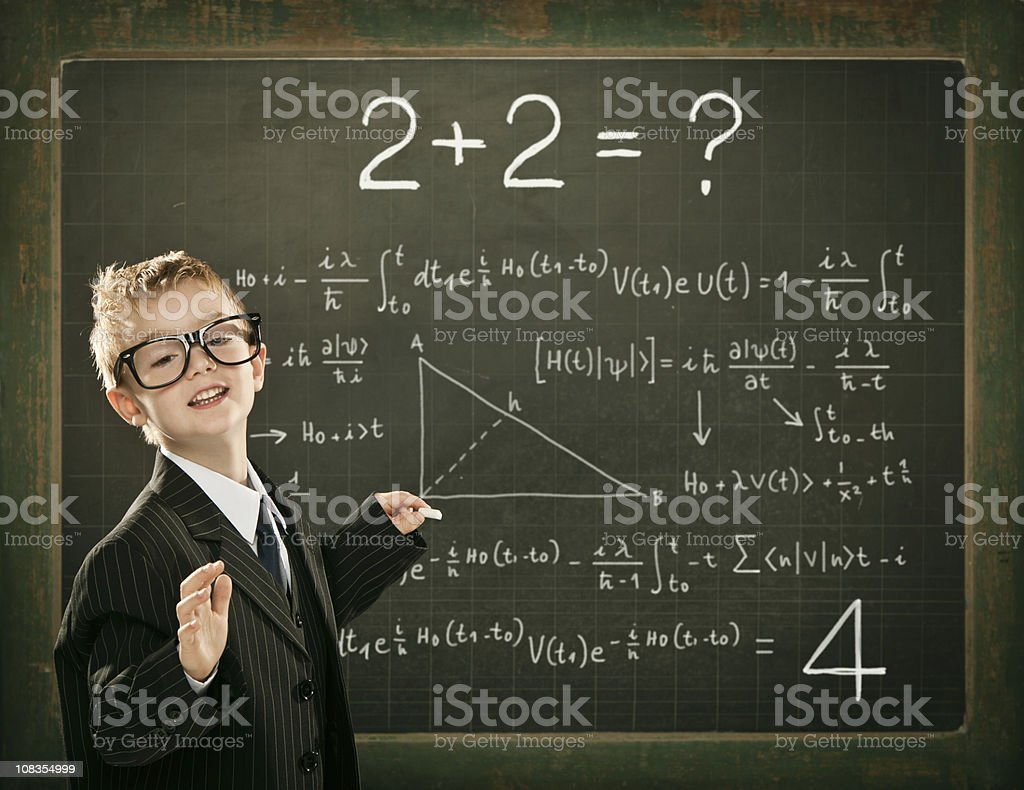 genius student or teacher resolve math problem on school blackbo stock photo