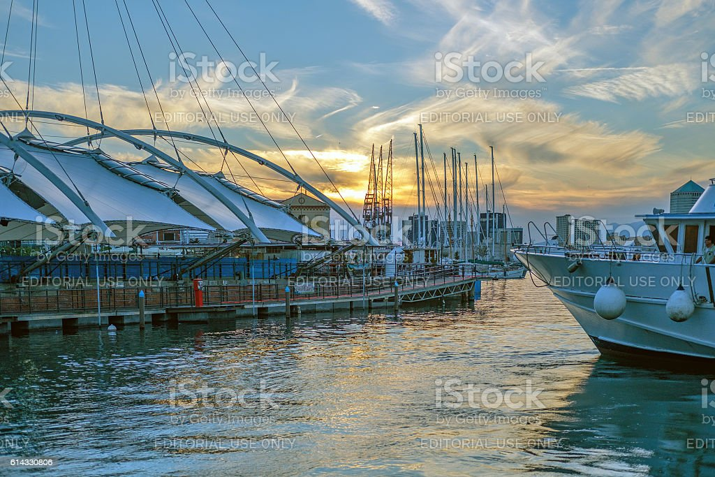Genoa harbour at sunset stock photo