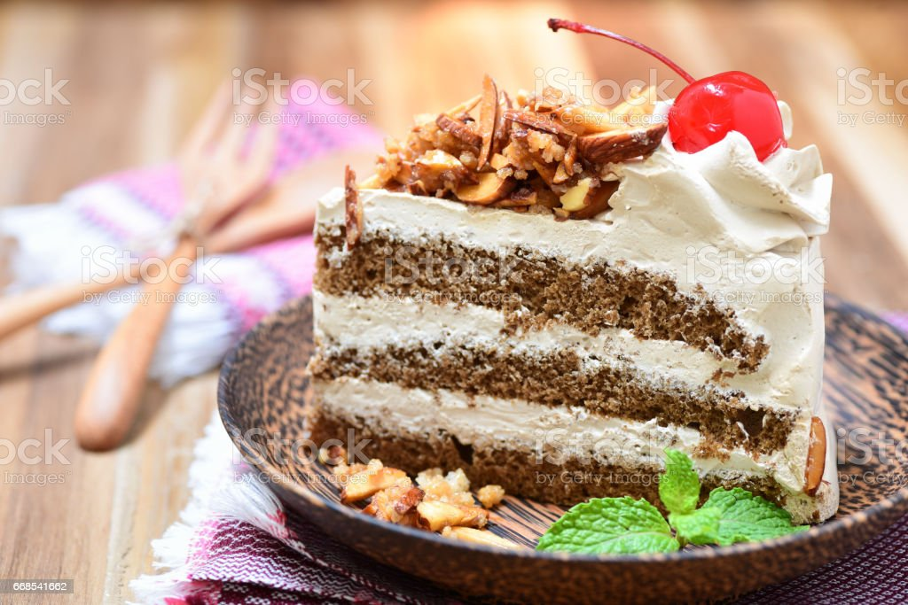 genoise coffee cake on wooden plate stock photo