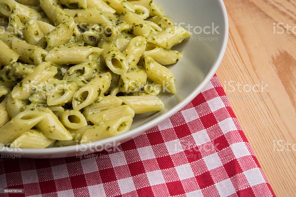 Genovese pesto sauce penne pasta stock photo