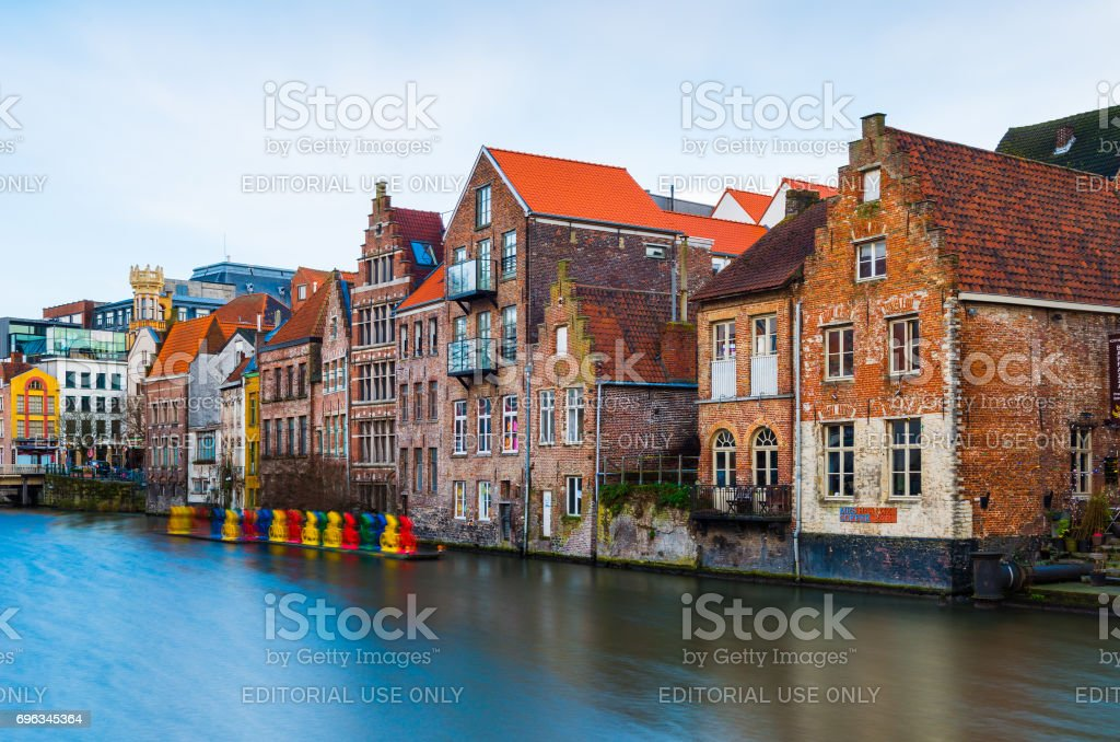 Gent, Belgium: Old medieval brick houses in traditional style and water canal in one of the most popular tourist destination of Belgium stock photo
