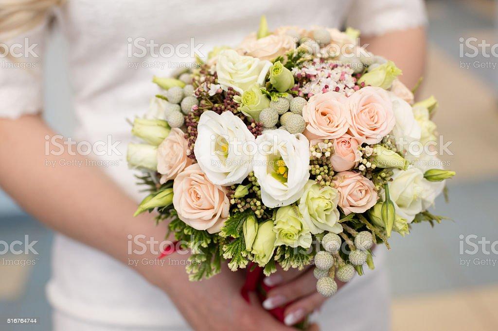 gentle bridal bouquet in hands stock photo