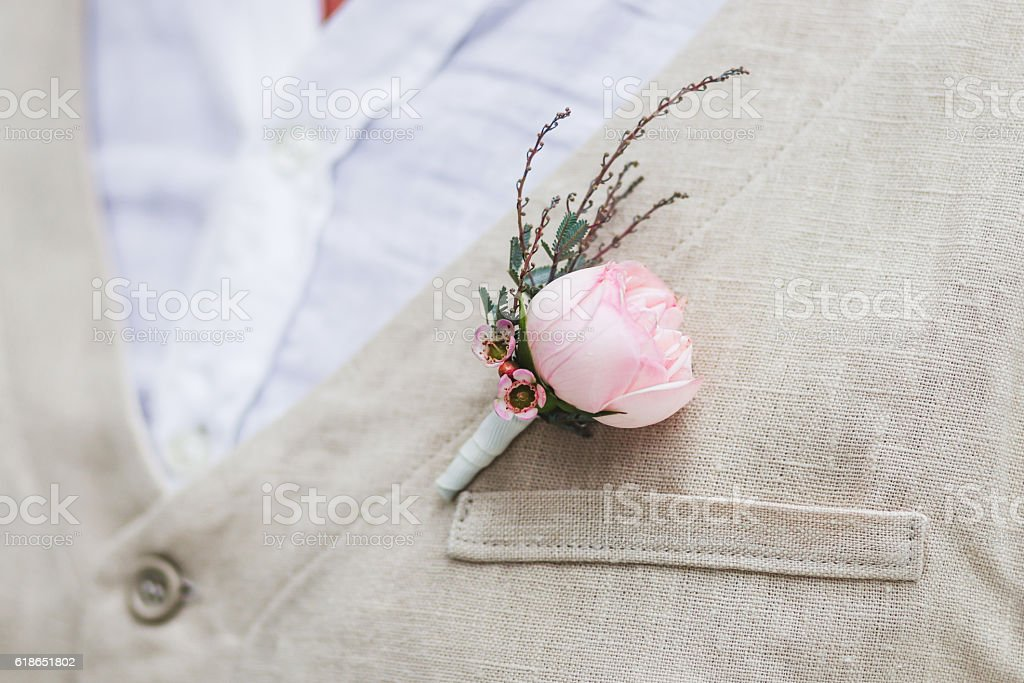 Gentle groom boutonniere with a rose stock photo
