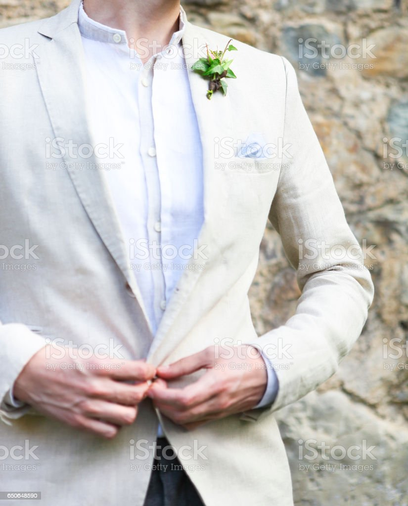Gentle groom boutonniere with ivy stock photo