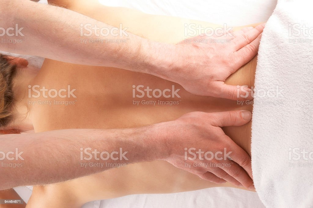gentle massage of the lower back royalty-free stock photo