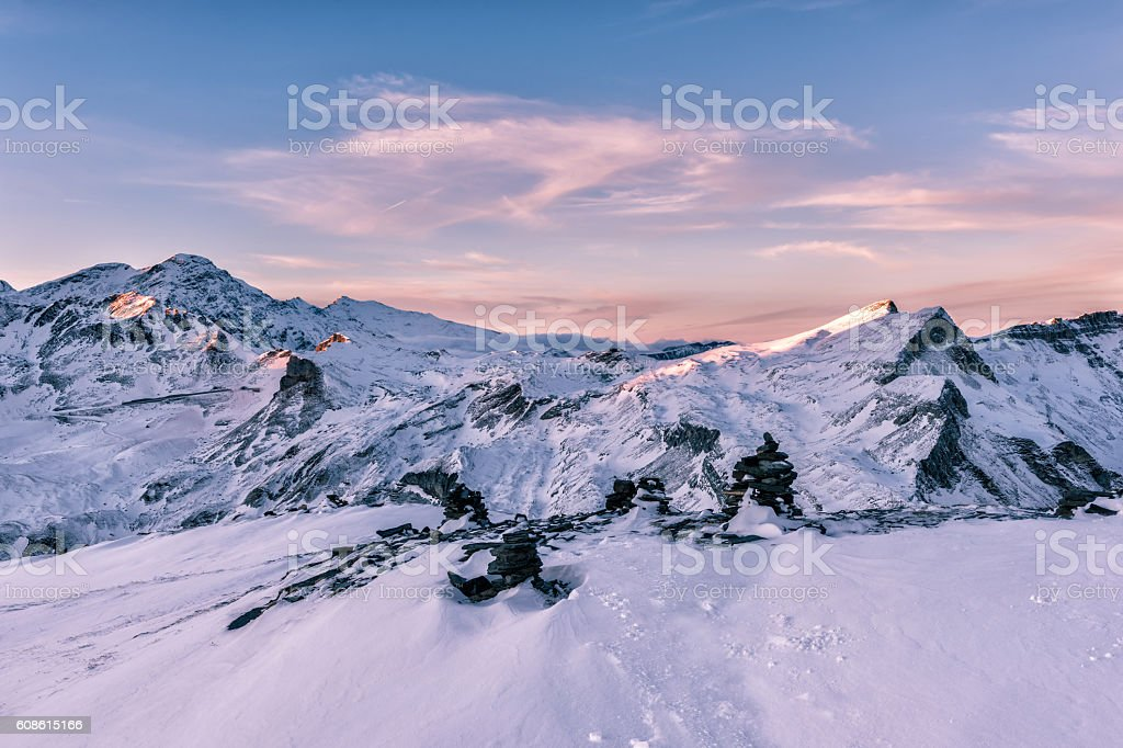 Gentle pink sunset light at winter Alps Mountains stock photo