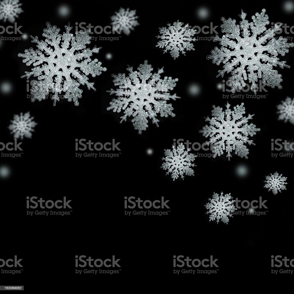 Gentle silver snowflakes on a black background royalty-free stock photo