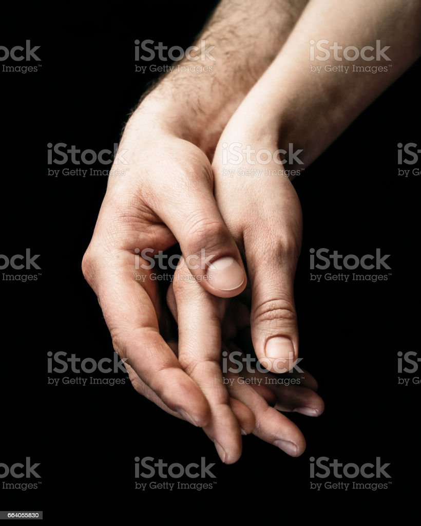 A gentle touch of two hands. stock photo