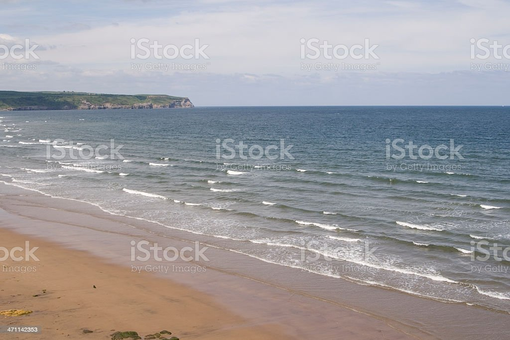Gentle waves lapping the beach stock photo