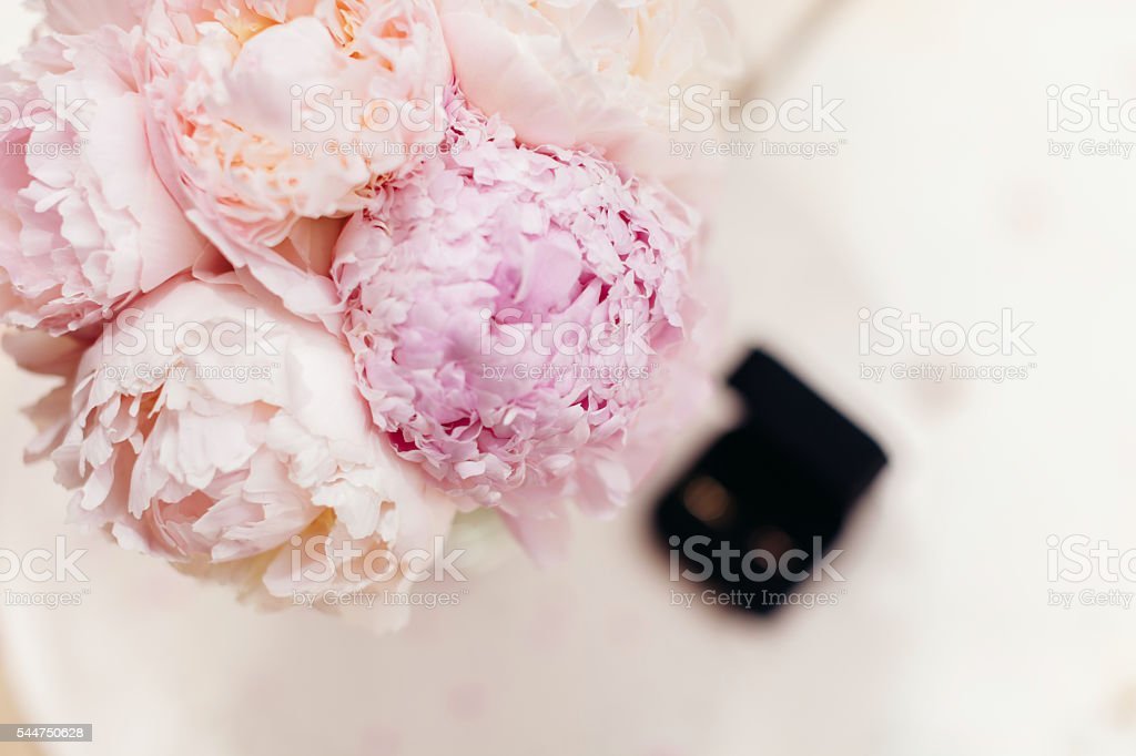gentle wedding bouquet peonies with rings background stock photo
