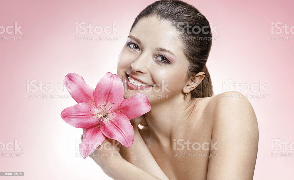 Gentle young woman with flower royalty-free stock photo