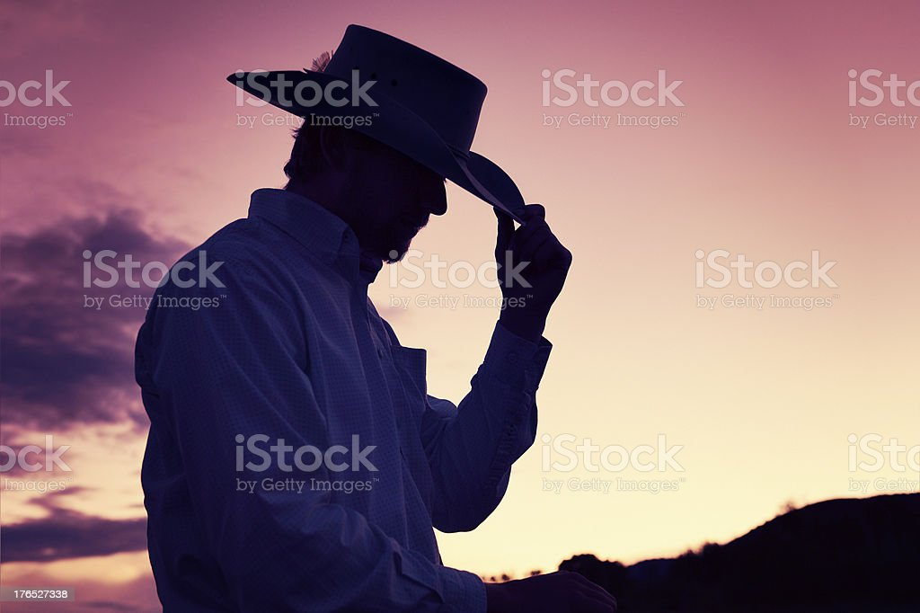 Gentleman Cowboy Tipping His Hat In A Western Sunset royalty-free stock photo