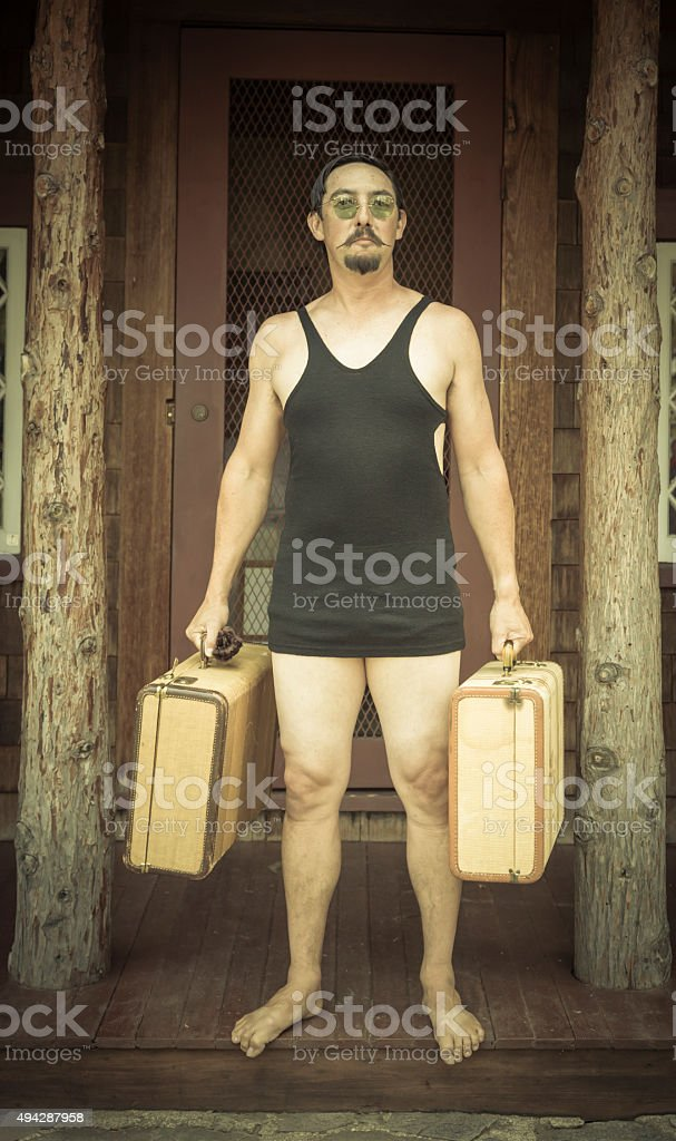 Gentleman Dressed in 1920's Era Swimsuit Holding Suitcases stock photo
