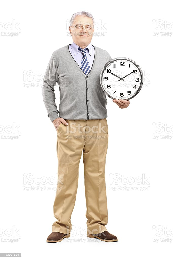 Gentleman holding a wall clock royalty-free stock photo