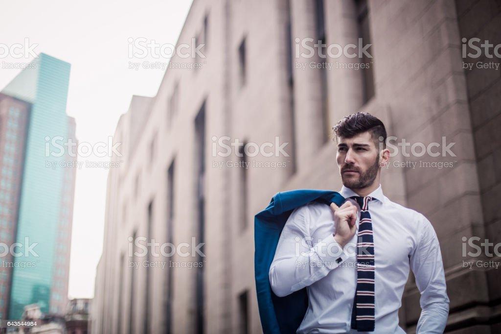 Gentleman in suit outdoors stock photo