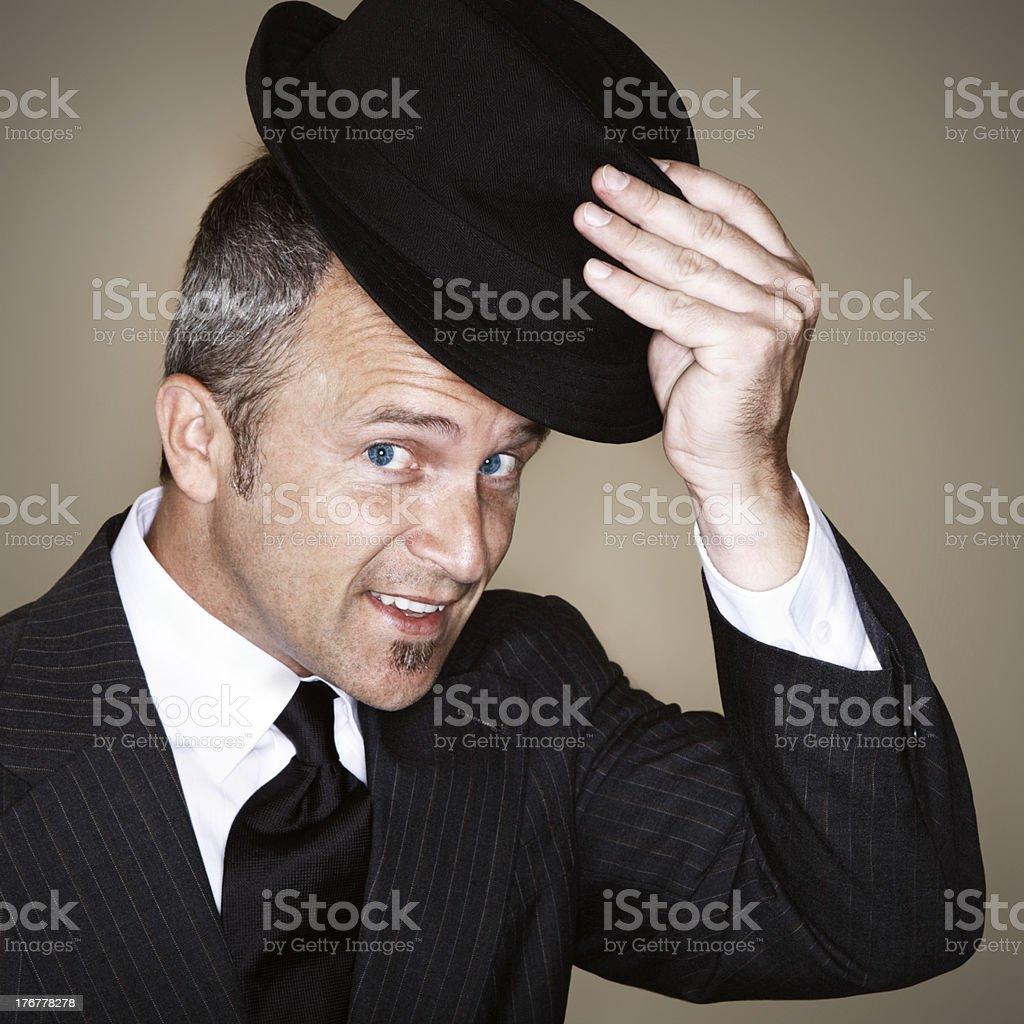 Gentleman Tipping Fedora stock photo