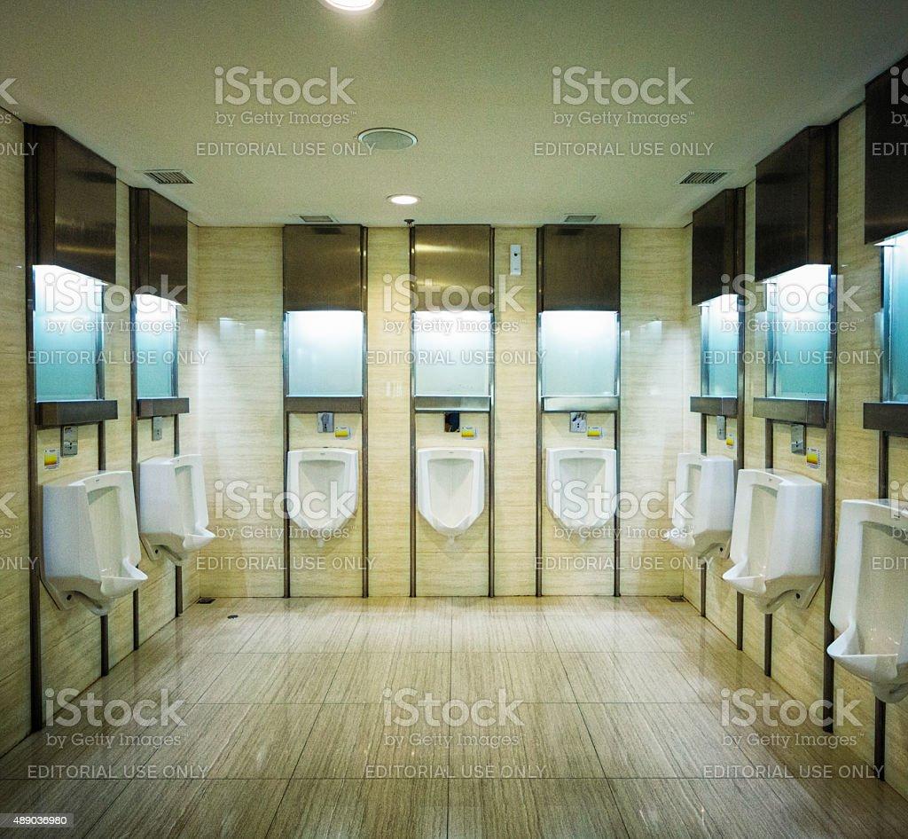 Gentlemen's water closet at New Ngurah Rai Denpasar International Airport stock photo